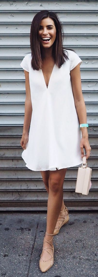 white tunic and nude